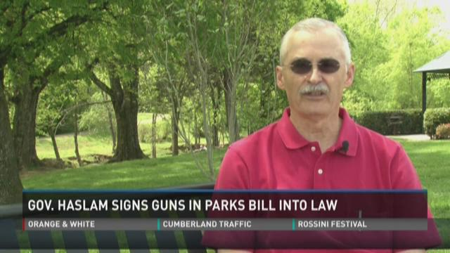 Signing of guns-in-parks law prompts reaction