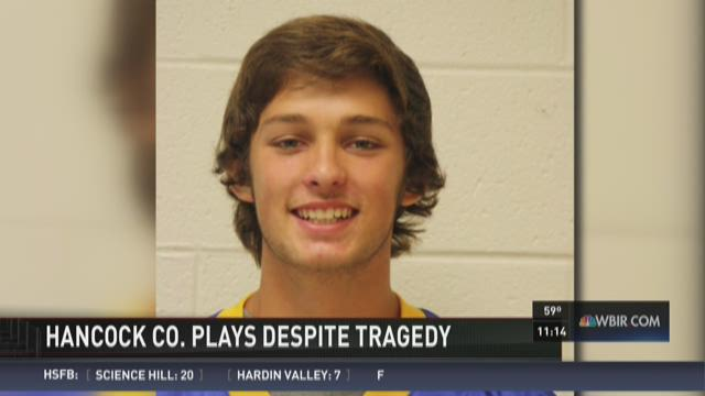 Hancock County plays despite quarterback's death